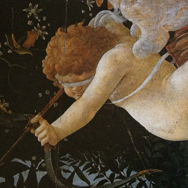 a blindfolded cupid flying and holding his bow and arrow