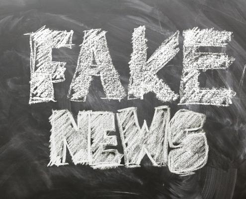 """Blackboard with """"fake news"""" written on it"""