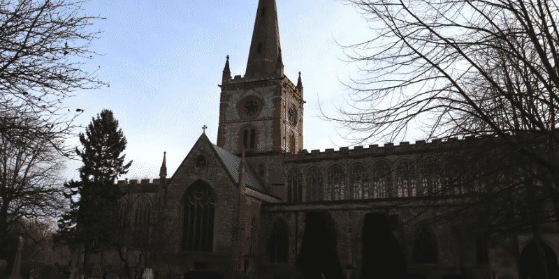 External shot of Shakespeare's Holy Trinity church, showing chancel and spire