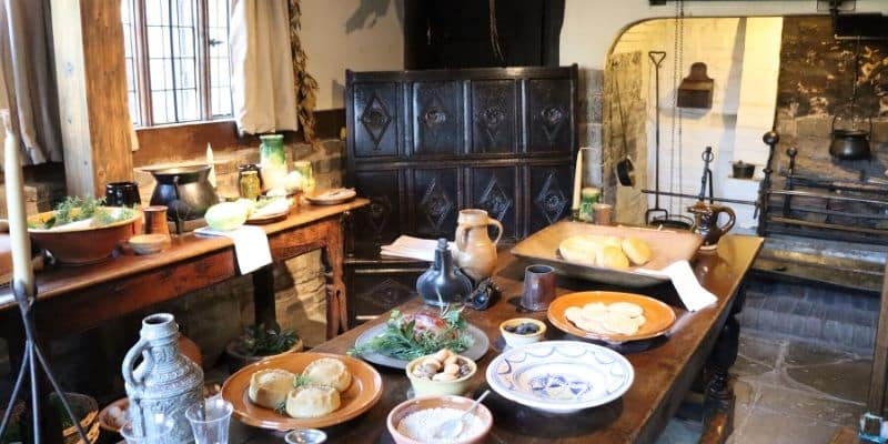 The kitchen at Hall's Croft, complete with Tudor meal laid out