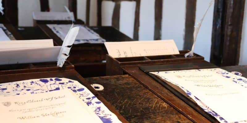 Closeup shot of old desk, quill and parchment, taken at Shakespeare's tudor school